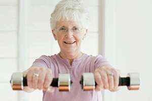 adult woman exercising with dumb bells