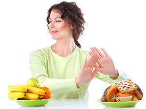 portrait of woman refusing junk foods