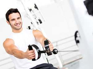 smiling man working out in the gym