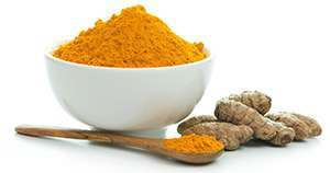 Turmeric Curcumin and bowl of turmeric powder