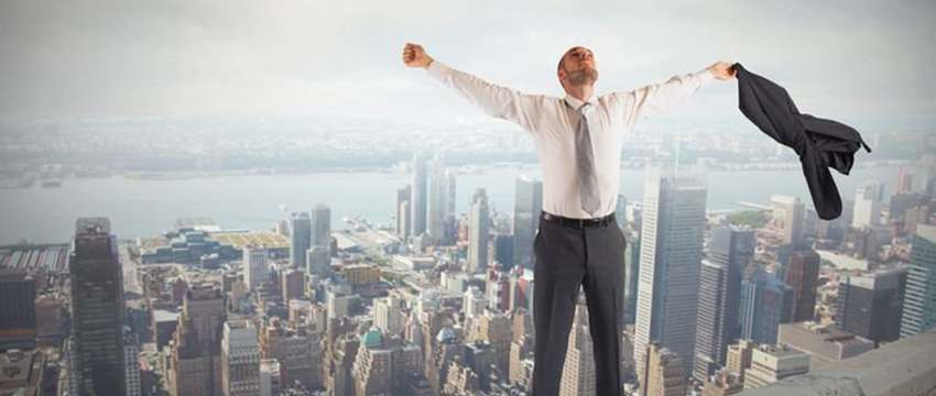 man feeling relief on top of a building