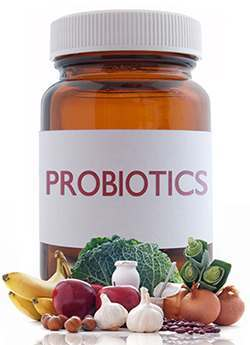 bottle of probiotic supplement and different vegetables